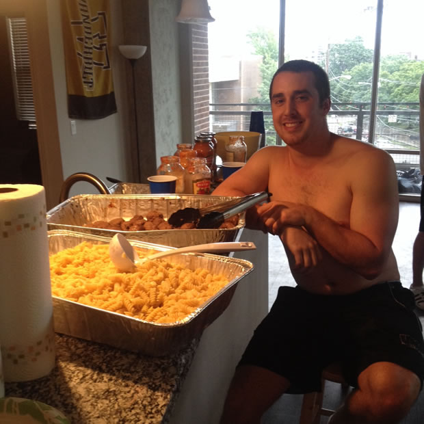 Senior Captain and Team Chef Anthony Bilotta posing shirtless with his world famous pasta and maple syrup meatballs
